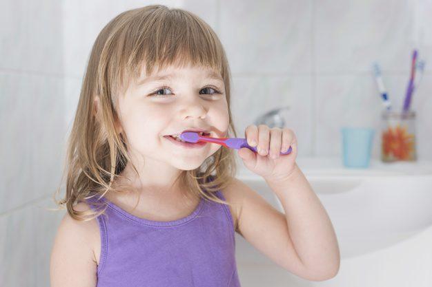 portrait girl brushing teeth with toothbrush